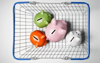 Piggy banks in shopping basket. Image shot 2011. Exact date unknown.