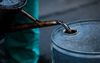 A worker pours liquid oil into a barrel at the delayed coker unit of the Duna oil refinery operated by MOL Hungarian Oil and Gas Plc in Szazhalombatta, Hungary, on Tuesday, July 9, 2013. Hungary refiner Mol may take part in oil exploration in Montenegro after country calls tender in July, daily Magyar Hirlap says. Photographer: Akos Stiller/Bloomberg via Getty Images